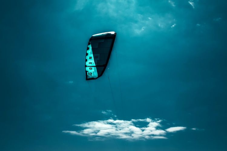 High angle view of boat in sea against blue sky