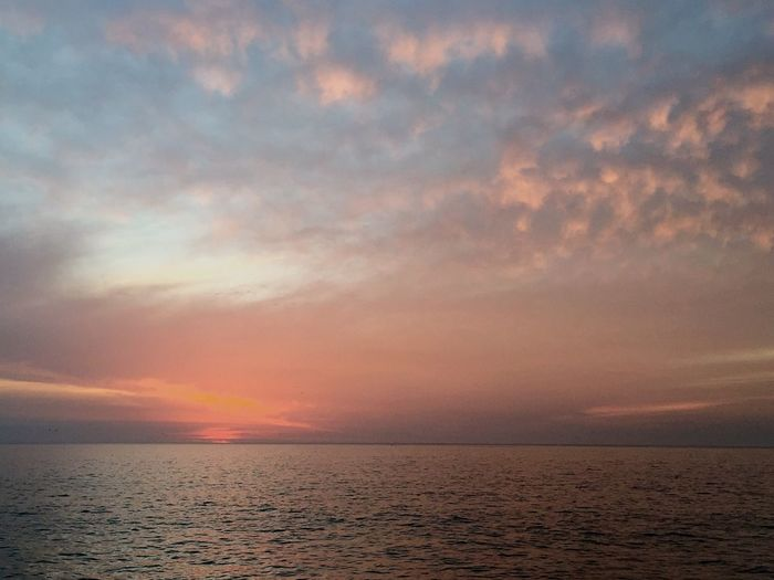 After The Sunset Sky Colors Pastel Sky Clouds And Sky Clouds Lovers Pastel Clouds Clouds And Sky Colors Sea And Sky Ocean View IPhoneography Capture The Moment Outdoors Reflections In The Water Horizon Over Sea Beauty In Nature Idyllic Showcase June Amazing Scenery