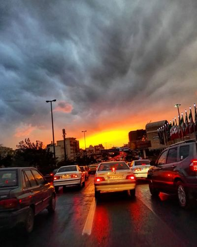 Car Traffic Transportation City Travel Cloud - Sky Mode Of Transport Dramatic Sky No People Road Driving Sunset Sky Outdoors Day