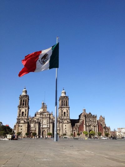 The giant Mexican flag in front of the Metropolitan Cathedral at the Zocalo square, Mexico City, Mexico. Zócalo Mexico City Mexican Flag Cathedral Mexico Landmark Place Of Interest Centro Historico Copy Space Tourism
