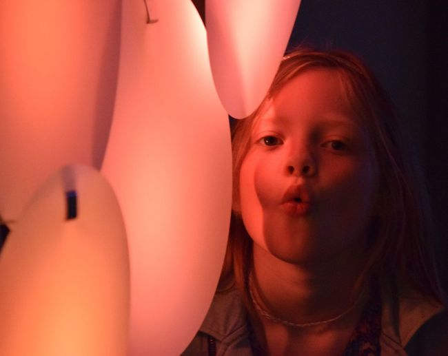 States Of Play exhibition at Humber Street Gallery, part of Hull UK City Of Culture 2017 Blowing Childhood Close-up Day Elementary Age Front View Girl Girls Happy Headshot Home Interior Hull Hull 2017 Hull City Of Culture 2017 Illuminated Indoors  Leisure Activity Lifestyles Light Looking At Camera One Person People Portrait Real People Young Adult