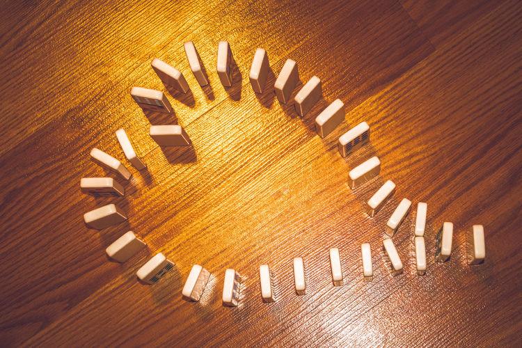 High angle view of heart shape on hardwood floor