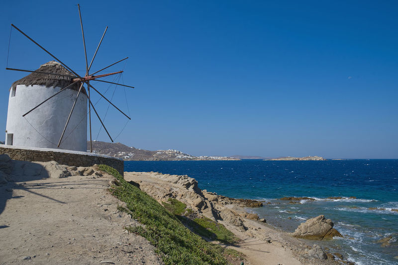 Chora village ( Windmills ) - Mykonos Cyclades island - Aegean sea - Greece Aegean Chora Windmill Alternative Energy Beach Beauty In Nature Blue Day Environment Environmental Conservation Fuel And Power Generation Greece Horizon Over Water Land Mykonos Nature No People Renewable Energy Scenics - Nature Sea Sky Turbine Water Wind Power Wind Turbine