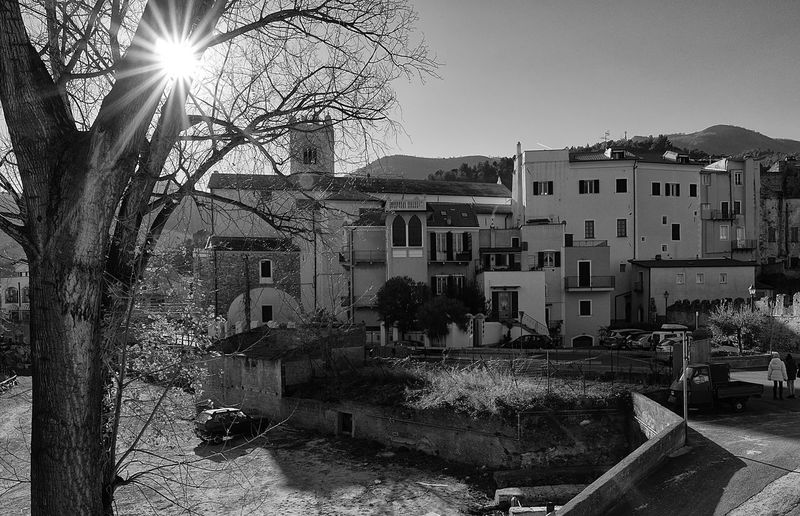 Panoramic view of Toirano from the medieval bridge over the Torrente Varatella Architecture Backlight Bell Tower Black & White Black And White Blackandwhite Bridge Building Exterior Built Structure City Cityscape Landscape Liguria Medieval Old Outdoors Sun Sunlight Toirano Town Tree Trunk Urban Varatella