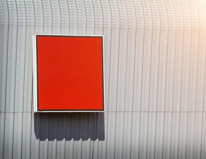 Red billboard on wall