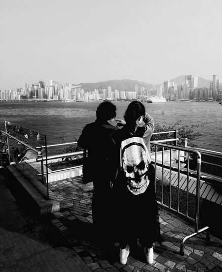 Love Two People Archival Clear Sky Rear View Togetherness Railing Warm Clothing Knit Hat Winter Water City Outdoors Women Connection People Sky Adult Day Adults Only Blackandwhite Black And White Streetphotography Hanging Out Hello World