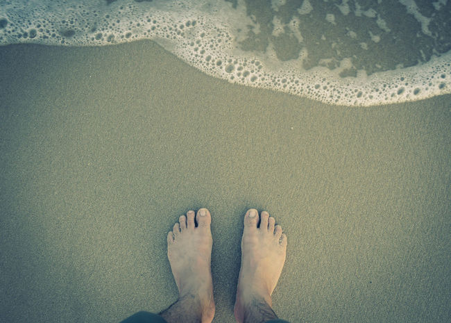 feet with wave on sandy beach top view Lifestyle person Retro Top Wave Adult Background barefoot Beach Feet Foam Human Body Part Leisure Activity Men Ocean People Relaxation Sand Sea Seaside Space Toe Water Waterfront Wet