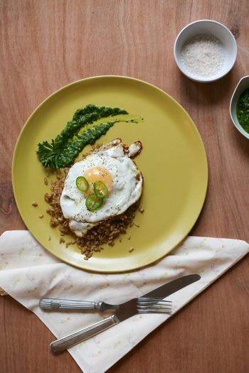 Pesto Bowl Breakfast Directly Above Egg Egg Yolk Food Food And Drink Fork Freshness Fried Egg Healthy Eating Healthy Food Healthy Lifestyle High Angle View Indulgence Jalapeños No People Plate Ready-to-eat Table
