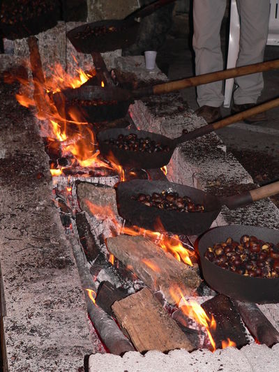 """The """"assembly line"""" of roasters Adult Burning Chesnut Day Flame Food Freshness Heat - Temperature No People Outdoors Roasted Chestnuts The Street Photographer - 2017 EyeEm Awards"""