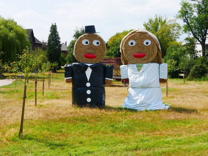 Straw dolls as a wedding couple Anthropomorphic Art And Craft Creativity Customs Day Face Field Grass Green Color Human Representation Land Landscape Nature No People Outdoors Park Park - Man Made Space Plant Representation Sky Sunlight Symbol Tree