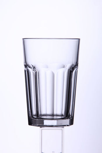 drinking glass on the white background Isolated Clean Clear Close-up Cut Out Cut Out On White Drink Drinking Glass Food Food And Drink Galss Liqueur No People Object Shot Glass Single Object Studio Shot Translucent Transparent White Background