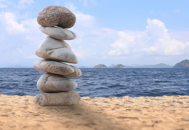 balance rock or zen stones on the beach in the day time. Time Balance And Composure Balanced Rock Beach Life Blue Sky White Clouds Rock Balance Balanced Beach Beach Day Blue Sky Blue Sky And Clouds Blue Sky And Sea Blue Sky White Clouds As Background Blue Sky With Clouds Rock - Object Rocks Stones Stones N Rocks Zen Zen Garden Zen-like