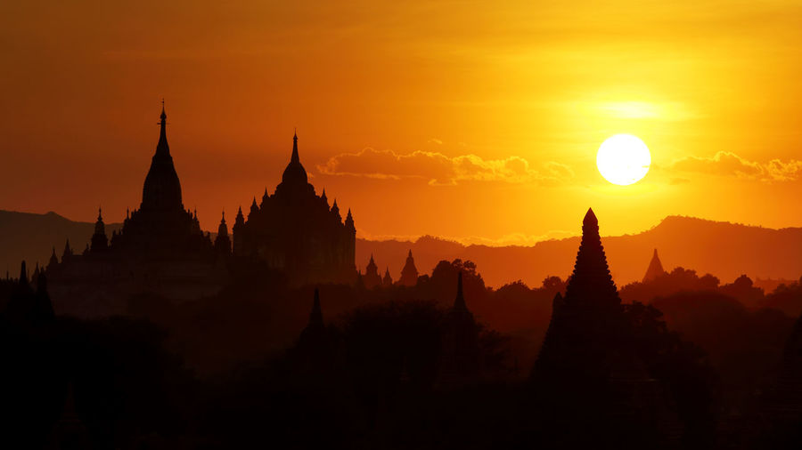 Beautiful scenery of silhouette ananda pagoda at during the sunset in the Bagan plain, Myanmar ASIA Pagoda Ancient Civilization Architecture Bagan Beauty In Nature Belief Building Exterior Built Structure History Myanmar Nature No People Orange Color Outdoors Place Of Worship Religion Silhouette Sky Spire  Spirituality Sun Sunset Tourism Travel Destinations
