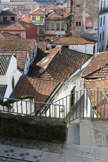 high angle view on various house roofs of the old town of porto, portugal Old Town Tiles Roofing Tile House Porto Portugal Sunny Construction High Angle View City Residential Building Roof Architecture Building Exterior Built Structure Townhouse Tiled Roof  Roof Tile Architectural Style Urban Scenery