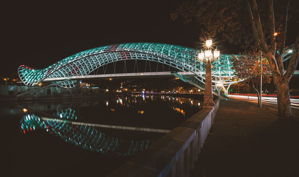 Night in Tbilisi Georgia Reflection Tbilisi Architecture Art Arts Culture And Entertainment Bridge Bridge - Man Made Structure Building Exterior Built Structure City Clear Sky Illuminated Long Exposure Night No People Outdoors Sky Structure Travel Destinations Tree