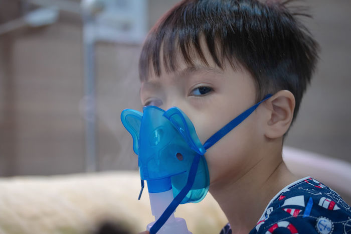 Kid sickness Respiratory Syncytial Virus. Asian  Care Hospital Medicine Respiratory Syncytial Virus Syncytial Asthma Boys Child Childhood Cure Equipment Headshot Health Innocence Looking Males  Medical Portrait Respiratory Rsv Sick Sickness Sprayer Virus