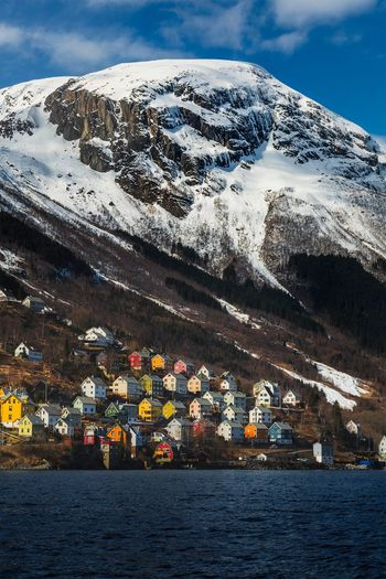 Fjord Village Colorful Scandinavia Hardangerfjorden Hardanger Norway Norge Fjord Odda Water Sky Nature Architecture Building Exterior Sea No People Mountain Snowcapped Mountain Winter Building Day