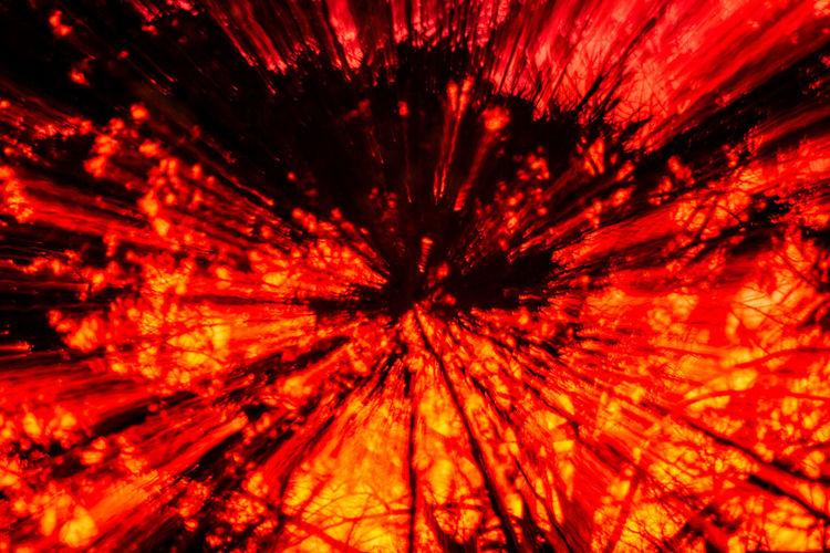 Full frame shot of illuminated red lights