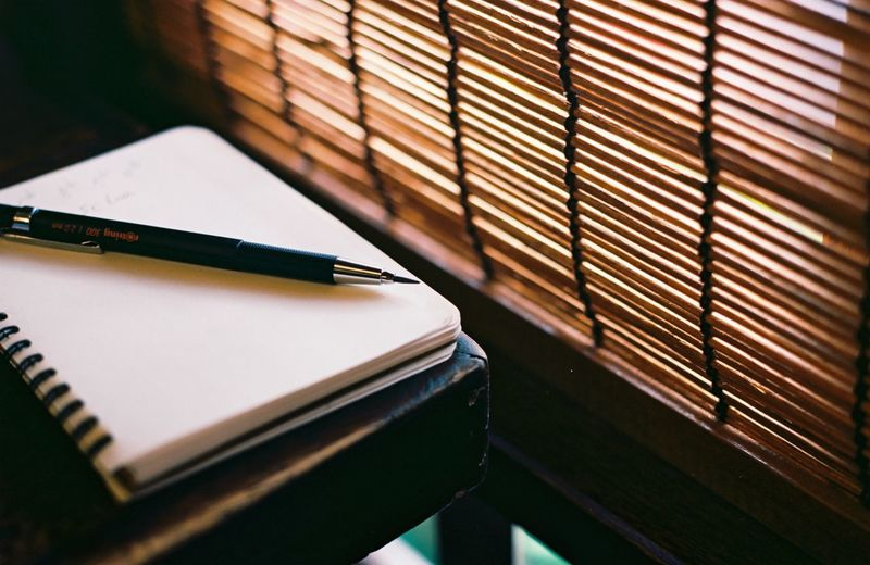 Writing something Book Still Life No People Table Indoors  Pen Note Pad Paper Pencil Studying Learning Wood - Material Writing Instrument