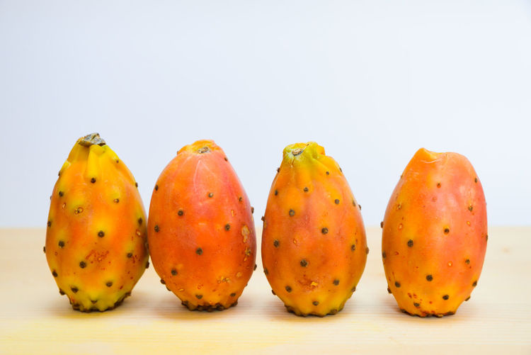 Close-up of oranges against white background