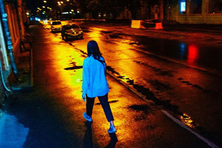 Full length of man walking on wet street