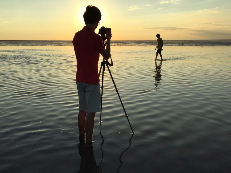 Taking Photos Enjoying Life Sunset Ocean Ocean View Photographer Two Is Better Than One Horizon Over Water Tranquility Tranquil Scene Water Sea Seaside People Photography People Fatherhood Moments Golden Hour EyeEm Best Shots Fine Art Photography