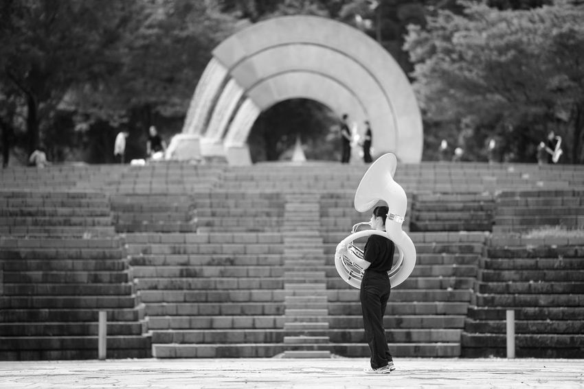 Capture The Moment Blackandwhite Monochrome One Person Real People Holding Instrument People One Young Woman Only Architecture Full Length Fine Art Photography Getting Inspired Uzu St. Streetphotography Outdoors Light And Shadow Selective Focus Depth Of Field Full Frame Detail Sony A7RII Sigma EyeEm Best Shots 17_10 EyeEmNewHere Second Acts Black And White Friday