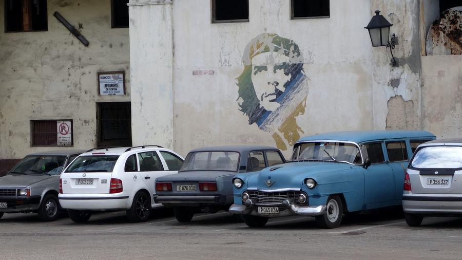 Che Guevara Mural in front of old cars, Havana, Cuba Che Guevara In Front Of Old Havana Cars Che Guevara Mural Cuba Cuba Collection Cuba Revolution Mural, Che Mural Revolution Revolutionary Art Street Of Havana, Cuba, Classic Car Of Havana, Street Of Havana
