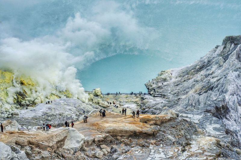 Panoramic view of people on kawah ijen volcano landscape