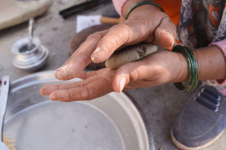 High angle view of woman making dough balls