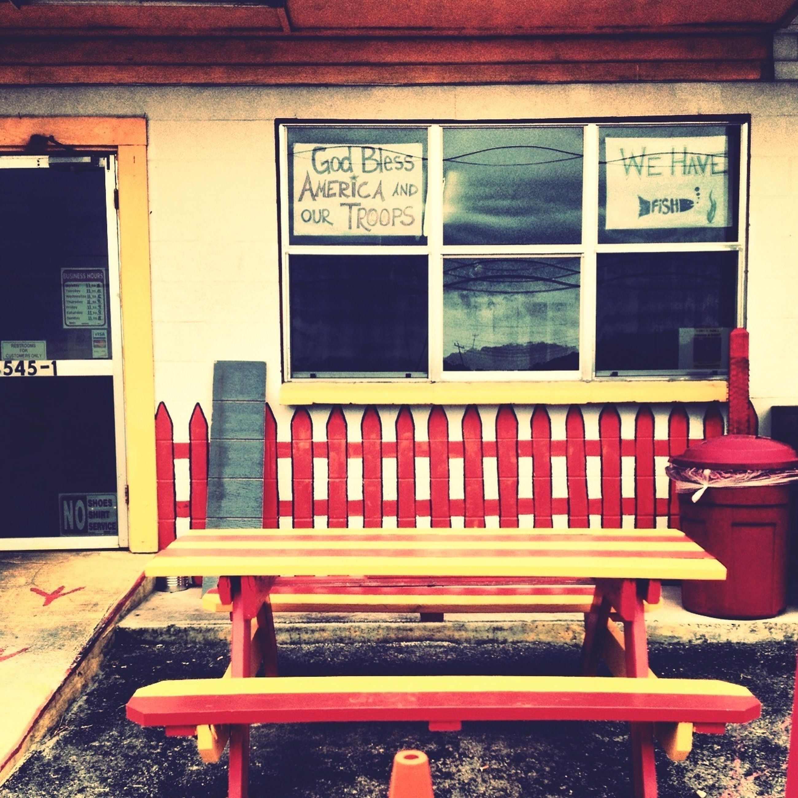 text, communication, western script, built structure, architecture, building exterior, chair, red, window, absence, empty, non-western script, day, seat, capital letter, closed, outdoors, information sign, no people, bench