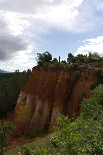 red clay of Roussillon France Green Provence Beauty In Nature Blue Sky And Clouds Cloud - Sky Day Landscape Nature No People Orange Color Outdoors Physical Geography Red Clay Rock - Object Rock Formation Roussillon Scenics Sky Tranquility Tree