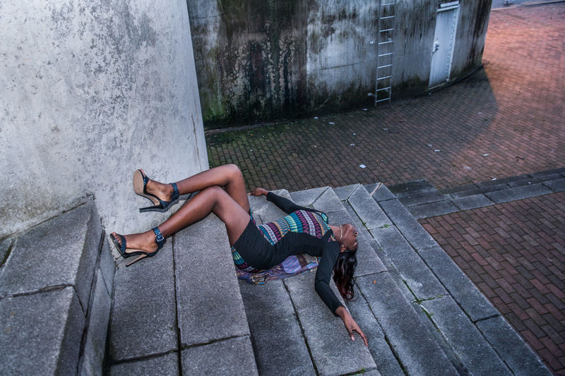 The Fashion Photographer - 2018 EyeEm Awards Architecture City Footpath Full Length High Angle View Lying Down One Person Outdoors Real People Young Adult