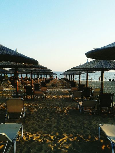 Clear Sky Water Outdoors Tranquil Scene Tranquility Day Tourism Sky Sea Beach Beachbar Umbrellas Sun Summertime Summermood Summeringreece Summer Vibes Chalkidiki Greece In A Row