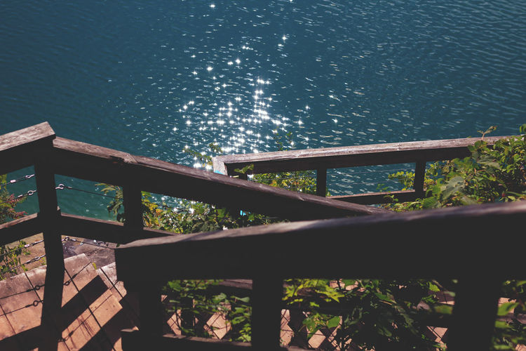Beauty In Nature Constellation Motion Nature No People Outdoors Railing Sea Sky Water Wood - Material
