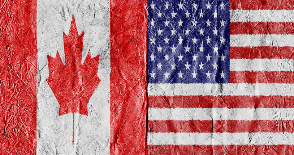Full Frame Shot Of Canadian And American Flags