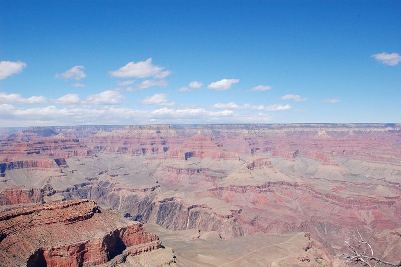 Scenic view of grand canyon national park against sky during sunny day