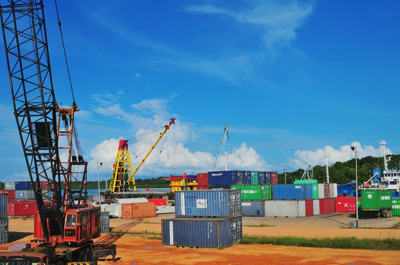 Container Port Container Ship EyeEm Selects EyeEmNewHere Container Port Jetty Industry Sky Crane - Construction Machinery Blue Business Finance And Industry Day Outdoors Industry Cloud - Sky No People Cargo Container Crane Shipyard Commercial Dock