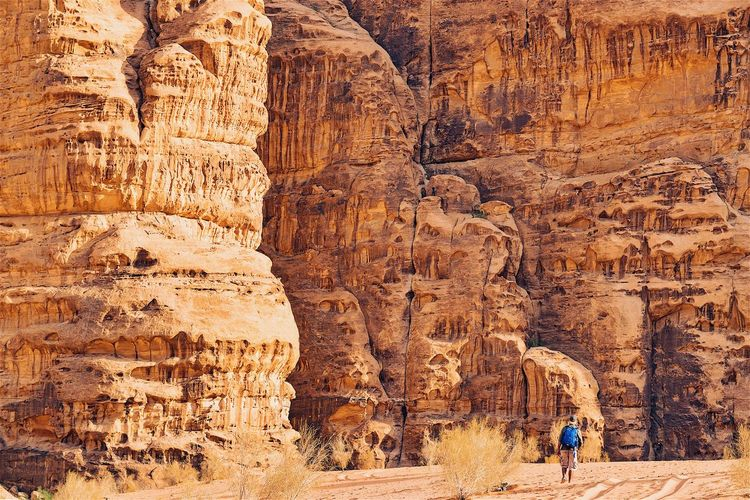 Wadi Rum Desert EyeEm EyeEm Best Shots EyeEm Gallery EyeEmNewHere Jordan The Week On EyeEm Travel Wadi Rum Adult Adults Only Adventure Arid Climate Beauty In Nature Cave Cliff Day Europe Eye4photography  Geology Hiking Landscape Leisure Activity Nature One Person Outdoors People Physical Geography Real People Rock - Object Rock Formation Rock Hoodoo Scenics Tranquility Travel Travel Destinations Wadi Rum National Park, Jordan Done That. Lost In The Landscape Perspectives On Nature