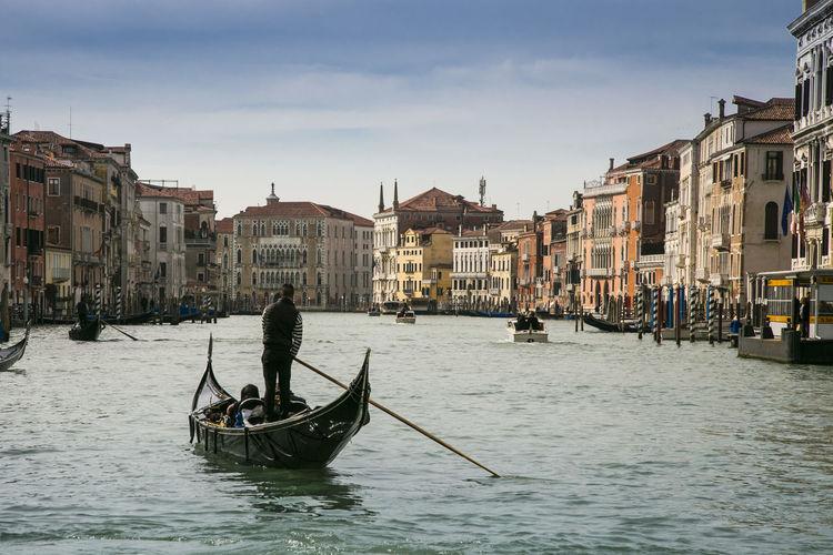 Adult Architecture Building Exterior Built Structure Canal Day Gondola - Traditional Boat Gondolier Men Mode Of Transport Nautical Vessel Oar One Man Only One Person Only Men Outdoors People Real People Rowing Sky Transportation Travel Destinations Water Waterfront