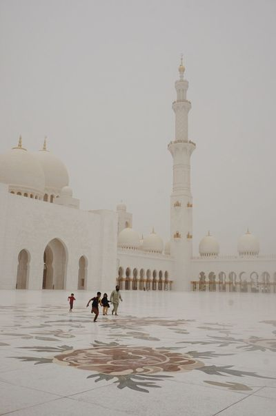 The Sheikh Zayed Mosque in Abu Dhabi Group Of People Religion History Place Of Worship Building Belief