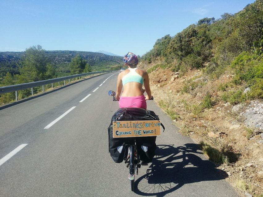 Bike touring in France was pretty hot at times : Rear View Only Women The Way Forward One Woman Only Clear Sky Outdoors Road Sky Tree Road Adventure Life On The Road Biketrip Road Trip Photograpghy EyeEmNewHere Travel Photography Biketouring Natural Beauty Roadtrip BikerGirl Bike Riding