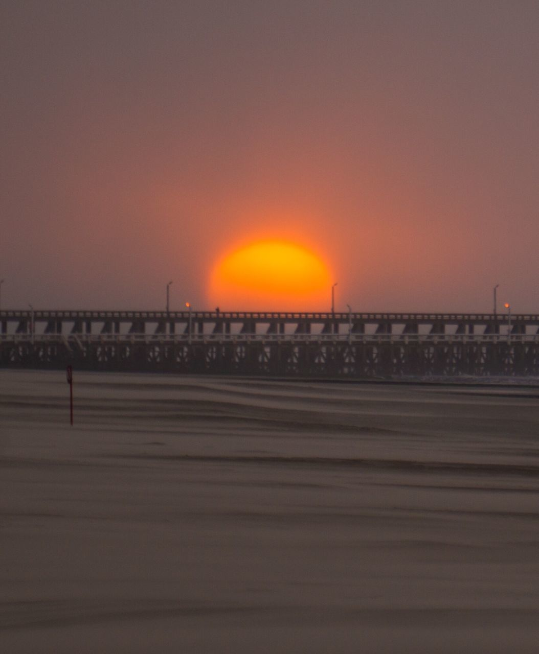Sun Set Above Bridge In Sea