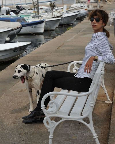 Young woman with dog on boat