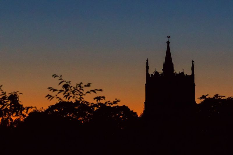 Church silhouette Blue Hour Sky Silhouette Architecture Built Structure Building Exterior Tree Sunset Building Travel Destinations Religion Plant Spirituality Tower Place Of Worship No People Tourism Low Angle View Copy Space The Past Nature