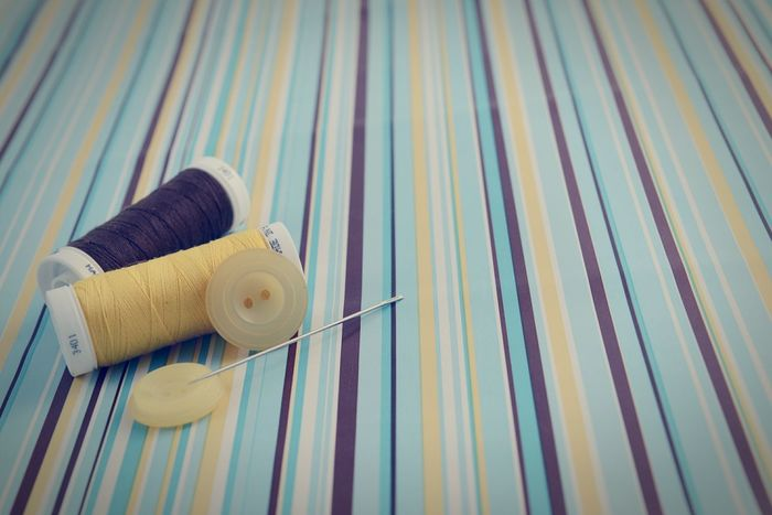 sewing rolls on striped paper background. Handmade Crafts Handcrafted Paper Background Stripes Everywhere Sewing Sewing Tools Sewing Kit Sewing By Hand Copy Space Copyspace Needle Sewing Needle Roll Button Buttons