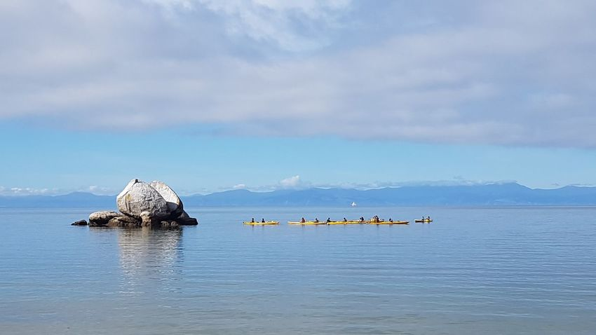 Kayaking Kayaking In Nature Split Apple Rock Beauty In Nature Cloud - Sky Day Floating On Water Mountain Nature No People Outdoors Scenics Sea Sky Tranquil Scene Tranquility Water