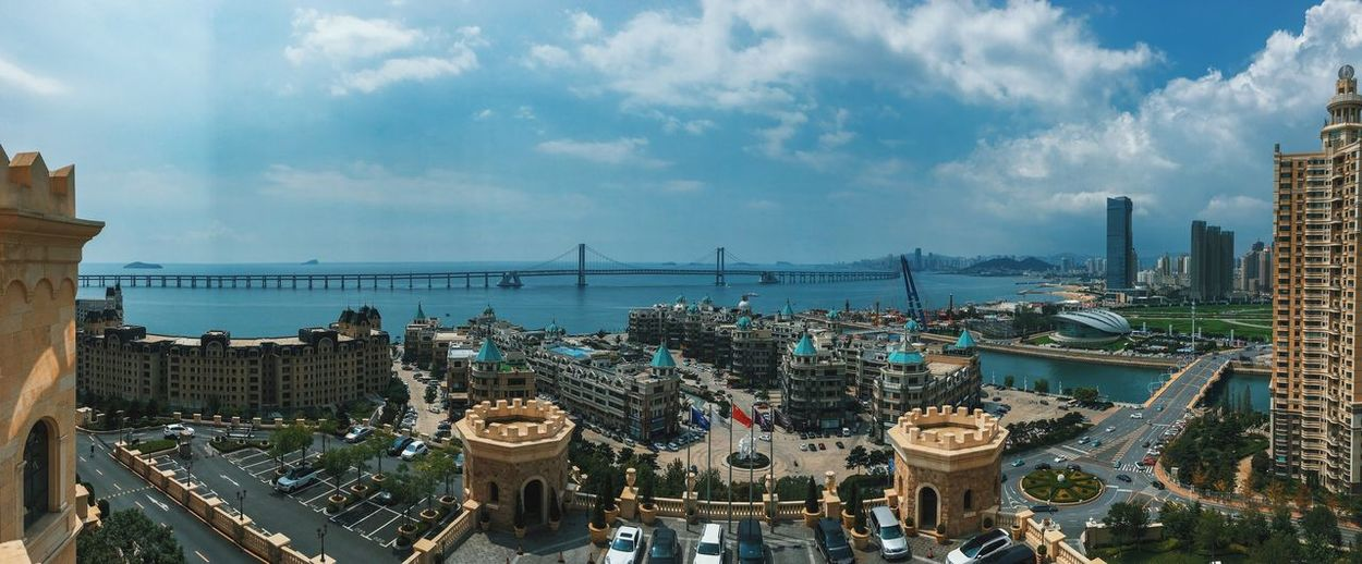 Dalian, Liaoning, China 2017 MelbournePhotographer IPhoneography Mobilephotography Streetphotography Adobelightroommobile Vscocam Panorama Architecture Built Structure Building Exterior Sky Cloud - Sky Cityscape Day Outdoors City Water Harbor Sea No People Panoramic Skyscraper Nature