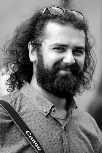 Facial Hair Beard Portrait Hairstyle Curly Hair Hair One Person Adult Headshot Long Hair Young Adult Men Indoors  Real People Close-up Studio Shot Looking Away Social Issues Human Hair