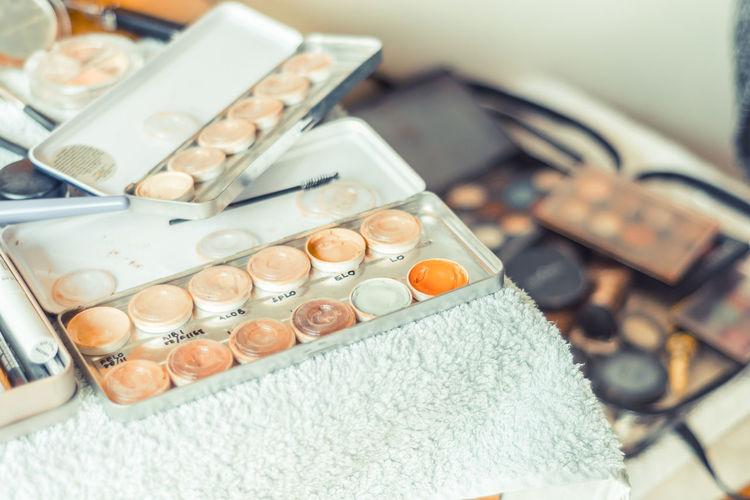 High angle view of make-up kits